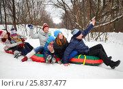 Купить «Six people on snow tubes down hill at winter. focus on man and girl teenager», фото № 25837477, снято 31 января 2015 г. (c) Losevsky Pavel / Фотобанк Лори