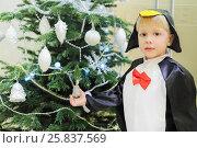 Купить «Half-length portrait of boy dressed as penguin standing near Christmas tree in living room, close-up», фото № 25837569, снято 19 декабря 2014 г. (c) Losevsky Pavel / Фотобанк Лори