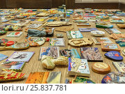 Купить «MOSCOW - FEB 10, 2015: Collection of souvenir magnets from different cities and countries are on table», фото № 25837781, снято 10 февраля 2015 г. (c) Losevsky Pavel / Фотобанк Лори