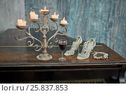 Купить «Old black grand piano with burning candles in candlestick, glass of red wine, high-heeled shoes and necklace on lid in room with ragged walls», фото № 25837853, снято 12 февраля 2015 г. (c) Losevsky Pavel / Фотобанк Лори