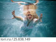Купить «Young blond woman in white dress swims with her eyes close in swimming pool underwater», фото № 25838149, снято 14 мая 2016 г. (c) Losevsky Pavel / Фотобанк Лори