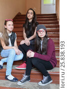 Купить «Three girls sitting together on stairs at school, looking into camera, focus on right girl», фото № 25838193, снято 20 марта 2015 г. (c) Losevsky Pavel / Фотобанк Лори