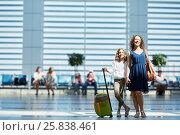 Купить «Smiling mother and daughter stand in waiting hall at airport», фото № 25838461, снято 20 августа 2015 г. (c) Losevsky Pavel / Фотобанк Лори