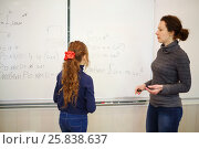 Купить «Schoolgirl and teather stand near blackboard with geometry example in classroom, text - solution, focus on child», фото № 25838637, снято 7 апреля 2016 г. (c) Losevsky Pavel / Фотобанк Лори