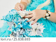 Купить «Hands of woman in blue fluffy dress with bunch of artificial flowers.», фото № 25838693, снято 29 марта 2015 г. (c) Losevsky Pavel / Фотобанк Лори
