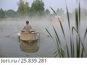 Купить «Young woman in boat in early summer morning floating down river to shore», фото № 25839281, снято 6 июля 2014 г. (c) Losevsky Pavel / Фотобанк Лори