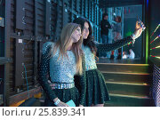 Купить «MOSCOW, RUSSIA - NOVEMBER 15, 2014: Propaganda Group makes selfie before going on stage at a party Diskach 90th in a club Space Moscow. Propaganda - Russian female pop group, founded in 2001», фото № 25839341, снято 15 ноября 2014 г. (c) Losevsky Pavel / Фотобанк Лори