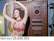 Купить «Half-length portrait of dancing young woman dressed in oriental style costume», фото № 25839393, снято 15 февраля 2015 г. (c) Losevsky Pavel / Фотобанк Лори