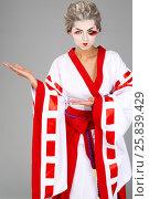 Купить «Girl in traditional Japanese costume and makeup points outstudio shot», фото № 25839429, снято 17 ноября 2014 г. (c) Losevsky Pavel / Фотобанк Лори