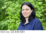 Купить «Humeral portrait of dark-haired smiling woman in green summer park», фото № 25839581, снято 22 мая 2016 г. (c) Losevsky Pavel / Фотобанк Лори
