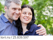 Купить «Closeup portrait of grey-haired man and dark-haired wooman standing embraced in summer park», фото № 25839597, снято 22 мая 2016 г. (c) Losevsky Pavel / Фотобанк Лори