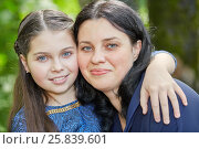 Купить «Closeup portrait of smiling teenage girl and dark-haired wooman embracing in summer park», фото № 25839601, снято 22 мая 2016 г. (c) Losevsky Pavel / Фотобанк Лори