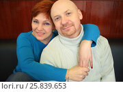 Купить «Portrait of a bald man and a red-haired woman sitting on a black sofa», фото № 25839653, снято 21 февраля 2015 г. (c) Losevsky Pavel / Фотобанк Лори