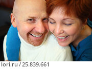 Купить «Portrait of happy bald man and a red-haired woman sitting on a black sofa», фото № 25839661, снято 21 февраля 2015 г. (c) Losevsky Pavel / Фотобанк Лори