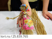 Купить «Female hands are holding a straw doll in colorful clothes, close-up», фото № 25839765, снято 22 февраля 2015 г. (c) Losevsky Pavel / Фотобанк Лори