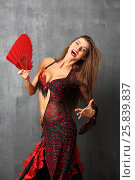 Купить «Portrait of laughing woman with flowing long hair in open red costume with fan», фото № 25839837, снято 22 ноября 2014 г. (c) Losevsky Pavel / Фотобанк Лори