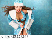 Купить «Portrait of beautiful Snow Maiden with long hair in blue coat and cap», фото № 25839849, снято 22 ноября 2014 г. (c) Losevsky Pavel / Фотобанк Лори