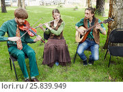 Купить «MOSCOW, RUSSIA - MAY 30, 2015: Musical Band Polca an Ri plays music in forest on summer day», фото № 25839949, снято 30 мая 2015 г. (c) Losevsky Pavel / Фотобанк Лори