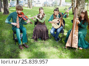 Купить «MOSCOW, RUSSIA - MAY 30, 2015: Musical Band Polca an Ri plays music outdoor in forest on summer day», фото № 25839957, снято 30 мая 2015 г. (c) Losevsky Pavel / Фотобанк Лори