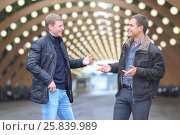 Купить «Two young man in black jacket on background of lights installation main park alley, talking and gesticulating», фото № 25839989, снято 25 октября 2015 г. (c) Losevsky Pavel / Фотобанк Лори