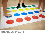 Купить «MOSCOW, RUSSIA - MAY 8, 2015: Children play Twister game in room. Twister is a game of physical skill produced by Milton Bradley Company and Winning Moves.», фото № 25840013, снято 8 мая 2015 г. (c) Losevsky Pavel / Фотобанк Лори