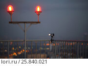 Купить «Camera takes time lapse on the roof of a high building near the lamppost with two signal lantern», фото № 25840021, снято 23 ноября 2014 г. (c) Losevsky Pavel / Фотобанк Лори