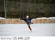 Купить «Young girl skating on one leg with arms outstretched to the sides on a skating rink», фото № 25840229, снято 23 февраля 2015 г. (c) Losevsky Pavel / Фотобанк Лори