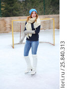 Купить «Young girl in a knitted cap, socks and mittens on a skating rink», фото № 25840313, снято 23 февраля 2015 г. (c) Losevsky Pavel / Фотобанк Лори