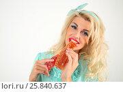 Купить «Beautiful happy girl with white hair eats sweet paste in white studio», фото № 25840637, снято 3 сентября 2015 г. (c) Losevsky Pavel / Фотобанк Лори