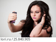 Купить «Dark-haired girl model makes selfies posing at studio», фото № 25840905, снято 11 января 2015 г. (c) Losevsky Pavel / Фотобанк Лори