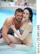 Купить «Portrait of a happy tanned man and light-skinned woman in pool at the aquapark», фото № 25841045, снято 28 февраля 2015 г. (c) Losevsky Pavel / Фотобанк Лори