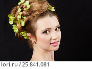 Купить «Close-up portrait of young woman with hairdress with green petals braided on dark background», фото № 25841081, снято 11 января 2015 г. (c) Losevsky Pavel / Фотобанк Лори