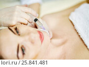 Купить «Beautician hands in rubber gloves makes injection into chin of woman lying on couch in beauty salon», фото № 25841481, снято 1 марта 2015 г. (c) Losevsky Pavel / Фотобанк Лори
