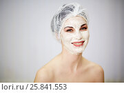Купить «Portrait of smiling woman with cosmetic mask on face and mesh hair cap on head», фото № 25841553, снято 1 марта 2015 г. (c) Losevsky Pavel / Фотобанк Лори