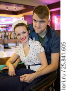 Купить «Young man and woman in retro dress hugging at the bar, focus on woman», фото № 25841605, снято 18 января 2015 г. (c) Losevsky Pavel / Фотобанк Лори