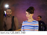 Купить «Portrait of beautiful singer with big eyes and dark hair in a striped dress in front of a drummer and guitar player», фото № 25841749, снято 9 декабря 2014 г. (c) Losevsky Pavel / Фотобанк Лори