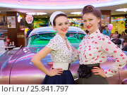 Купить «Two beautiful young girls in retro dress have a fun at the bar w», фото № 25841797, снято 18 января 2015 г. (c) Losevsky Pavel / Фотобанк Лори