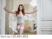 Купить «Young woman in white underwear, stockings and angel wings behind her back in room against doorway with her hands on doors», фото № 25841853, снято 10 июня 2016 г. (c) Losevsky Pavel / Фотобанк Лори