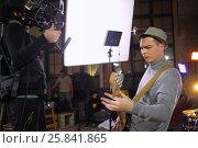 Купить «Professional video shooting a musician playing the guitar in the studio», фото № 25841865, снято 9 декабря 2014 г. (c) Losevsky Pavel / Фотобанк Лори