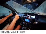 Купить «Hands of woman who drives car in illuminated tunnel.», фото № 25841869, снято 7 августа 2016 г. (c) Losevsky Pavel / Фотобанк Лори