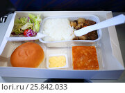 Купить «Different meals of breakfast is on table at plane during flight», фото № 25842033, снято 5 ноября 2015 г. (c) Losevsky Pavel / Фотобанк Лори