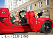 Купить «MOSCOW - SEP 13, 2015: Woman (with model release) in Lotus cabriolet car. Lotus Cars - British manufacturer of sports and racing cars», фото № 25842065, снято 13 сентября 2015 г. (c) Losevsky Pavel / Фотобанк Лори