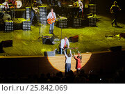 Купить «MOSCOW, RUSSIA - APR 24, 2015: N.Fomenko takes flowes from boy and girl on stage in Crocus city hall. Secret band presents concert program On any side of Earth.», фото № 25842069, снято 24 апреля 2015 г. (c) Losevsky Pavel / Фотобанк Лори