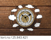 Купить «3D Clock with Cloud illustrion drawings against wood», фото № 25843421, снято 24 января 2019 г. (c) Wavebreak Media / Фотобанк Лори