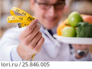 Купить «Doctor in dieting concept with fruits and vegetables», фото № 25846005, снято 15 декабря 2016 г. (c) Elnur / Фотобанк Лори
