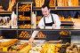 Seller offering fresh tasty bun, фото № 25846061, снято 26 января 2017 г. (c) Яков Филимонов / Фотобанк Лори