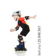 Купить «Little boy riding on the rollers», фото № 25848561, снято 5 января 2017 г. (c) Сергей Колесников / Фотобанк Лори