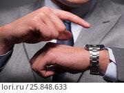 Businessman in time management concept. Стоковое фото, фотограф Elnur / Фотобанк Лори