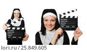 Купить «Nun with movie board isolated on white», фото № 25849605, снято 6 апреля 2014 г. (c) Elnur / Фотобанк Лори