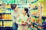 Female shopper with teenage daughter searching for beverages, фото № 25854521, снято 5 января 2017 г. (c) Яков Филимонов / Фотобанк Лори